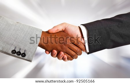 African businessman shaking hands with white one - stock photo