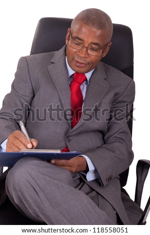 african businessman sitting in office chair isolated on white - stock photo
