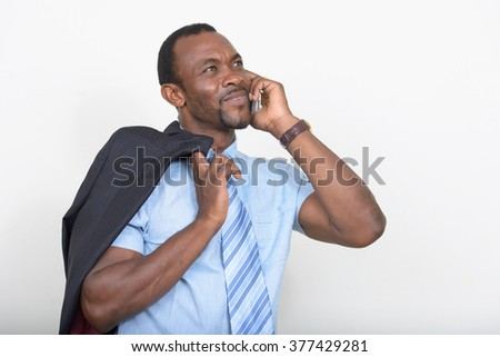 African businessman talking on phone - stock photo