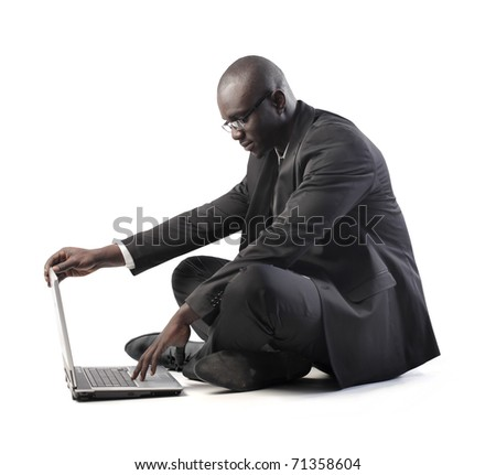 African businessman using a laptop - stock photo