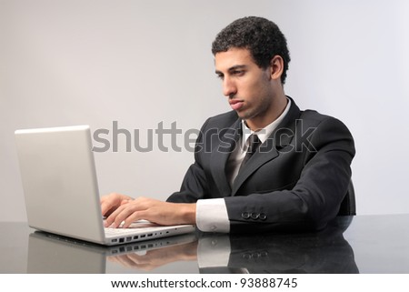 African businessman using a laptop
