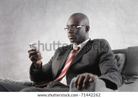 African businessman using a mobile phone - stock photo
