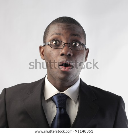 African businessman with astonished expression - stock photo