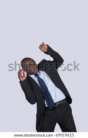 African businessman with fear from above and a strange face expression (isolated on gray - stock photo