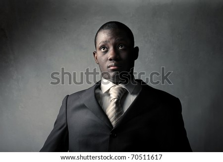 African businessman with worried expression - stock photo