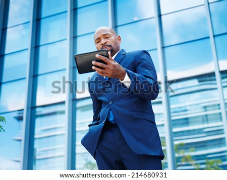 african businessman working on a tablet