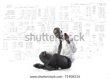 African businessman writing some stats - stock photo