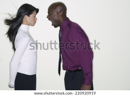 African businessman yelling at coworker - stock photo