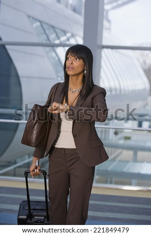 African businesswoman checking watch