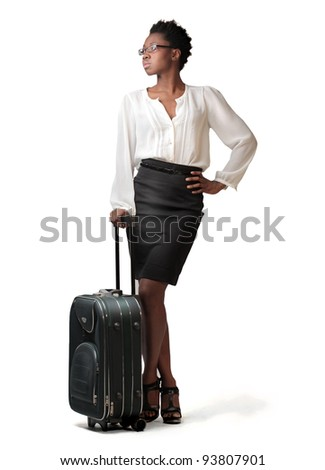 African businesswoman holding a trolley case - stock photo