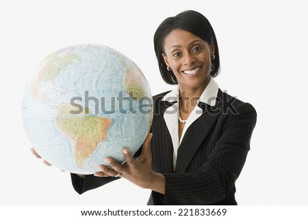African businesswoman holding globe