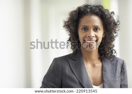 African businesswoman smiling - stock photo
