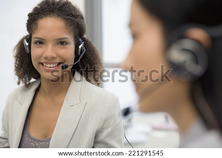 African businesswoman wearing headset - stock photo