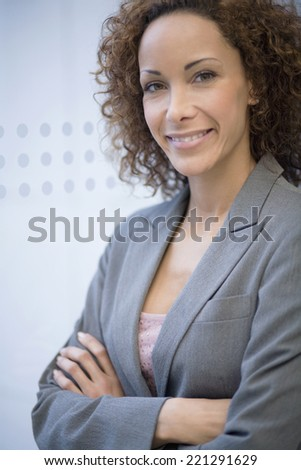 African businesswoman with arms crossed - stock photo