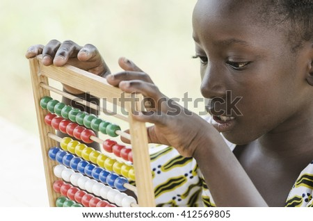 African Child Playing and Learning to Count - stock photo