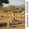 African child playing football at the cattle post - stock photo