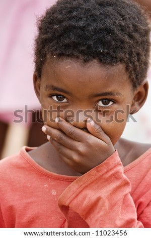 African children hand at the mouth, social issues and poverty series, - stock photo