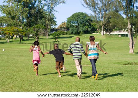 african children running in the park - stock photo
