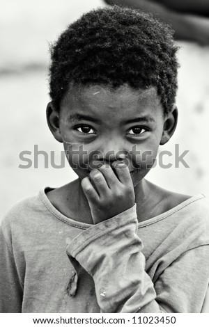 African children, social issues, poverty, black and white version - stock photo