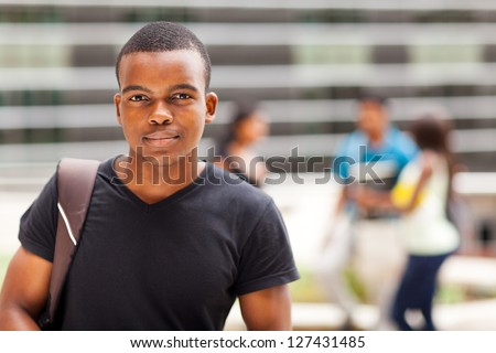 african college boy outdoors - stock photo