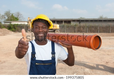 African construction worker with pipe showing thumb - stock photo