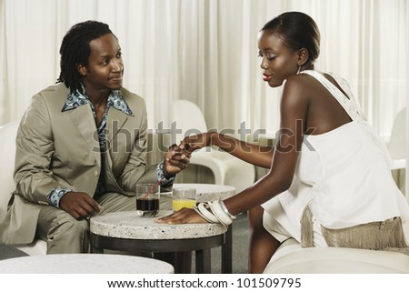 African couple holding hands at bar - stock photo