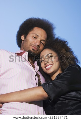 African couple hugging - stock photo