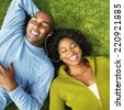 African couple listening to same mp3 player - stock photo