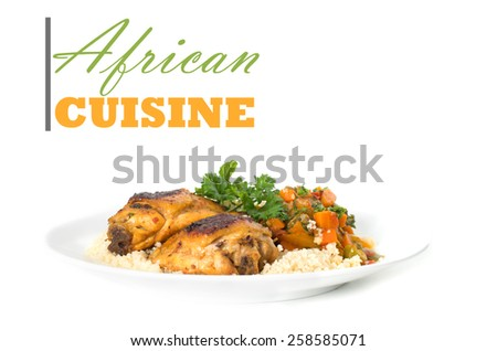 African cuisine concept with chicken thigh on couscous rice with copy space - stock photo