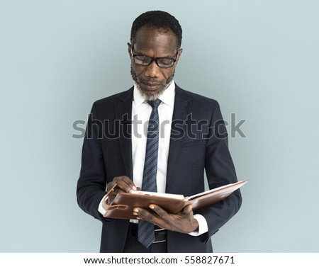 African Descent Business Man Notebook Portrait