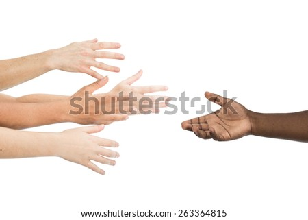 African descent hand reaching for caucasian hands - stock photo