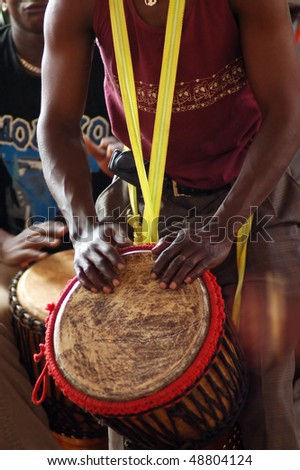 African djembe drummer in action - stock photo