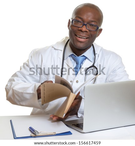 African doctor reading medical records