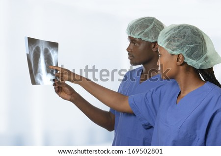 African doctors watching x-ray image of lungs, Studio Shot - stock photo