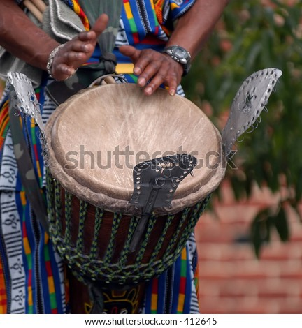 african drummer performs, this is a detail of hands beating the drum. - stock photo
