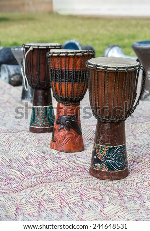 african drums on a carpet outdoors - stock photo