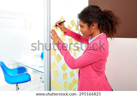 African ethnic executive with stickers in office young business woman