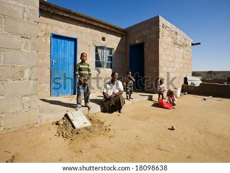 african family, grandmother and the grandchildren, living  in a very poor village near Kalahari desert - stock photo