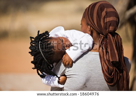 african family, mother and child, living  in a very poor village near Kalahari desert