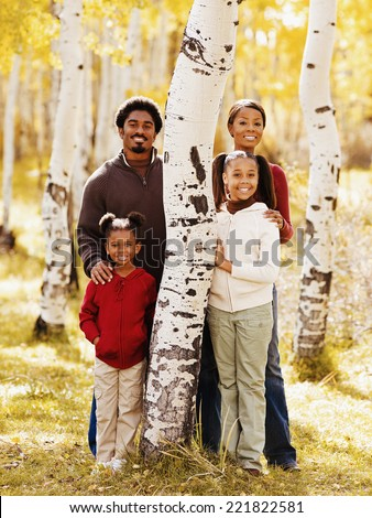 African family standing next to tree - stock photo