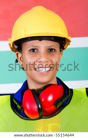 african female industrial worker closeup - stock photo