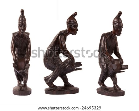African folk art wooden carving man playing drum - stock photo