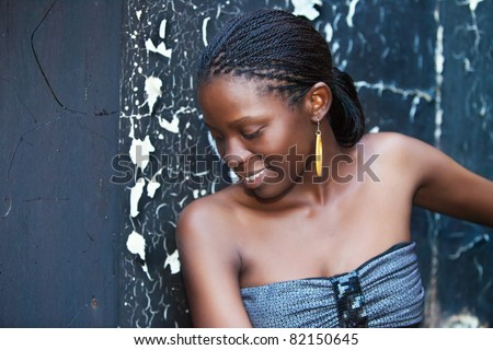 african girl outdoors grungy burned wall and mirror background - stock photo
