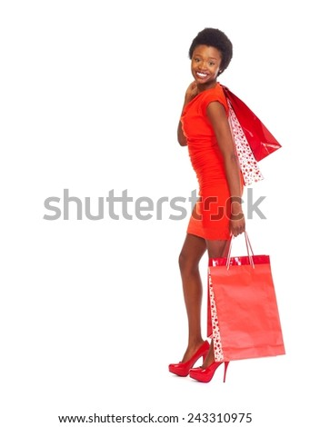 African girl with shopping bags  isolated white background - stock photo