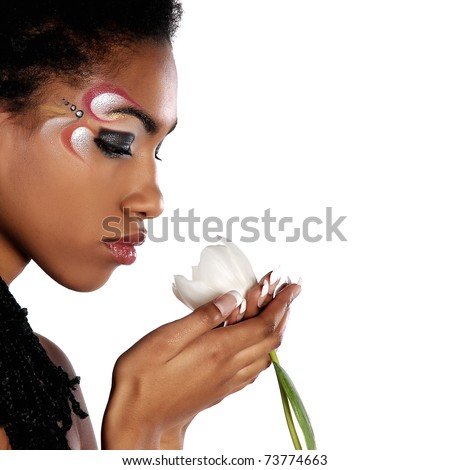 African girl with white tulips - stock photo