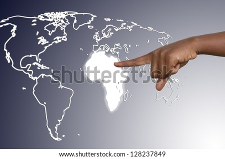 African hand touching map of africa on virtual touchscreen, studio shot - stock photo