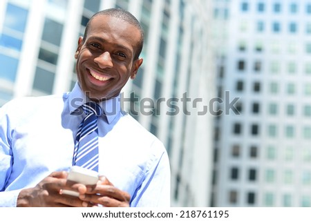 African handsome businessman at outdoors with smart phone - stock photo