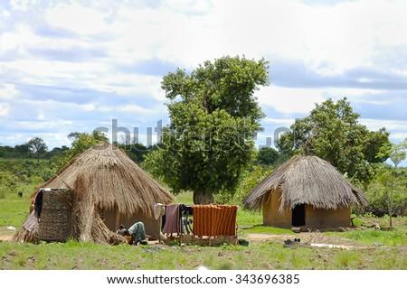 African Huts - Zambia - stock photo