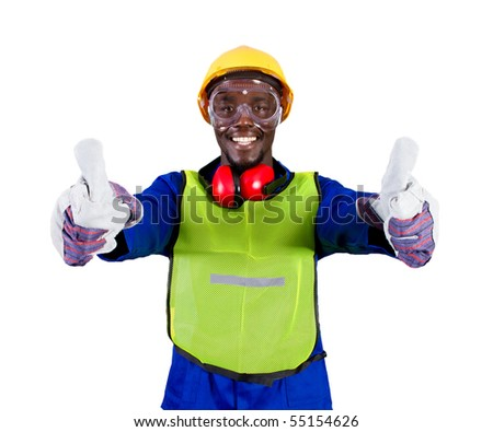african industrial worker giving thumbs up - stock photo