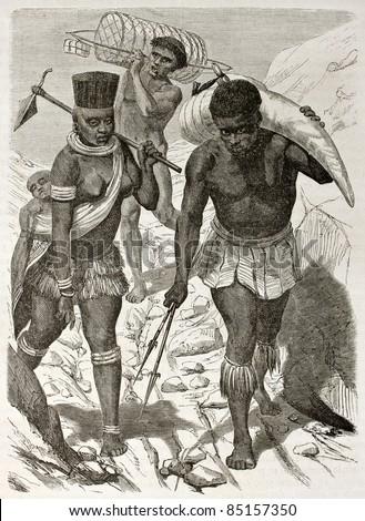 African ivory bearer old illustration. Created by Boulanger after Burton, published on Le Tour du Monde, Paris, 1860. - stock photo